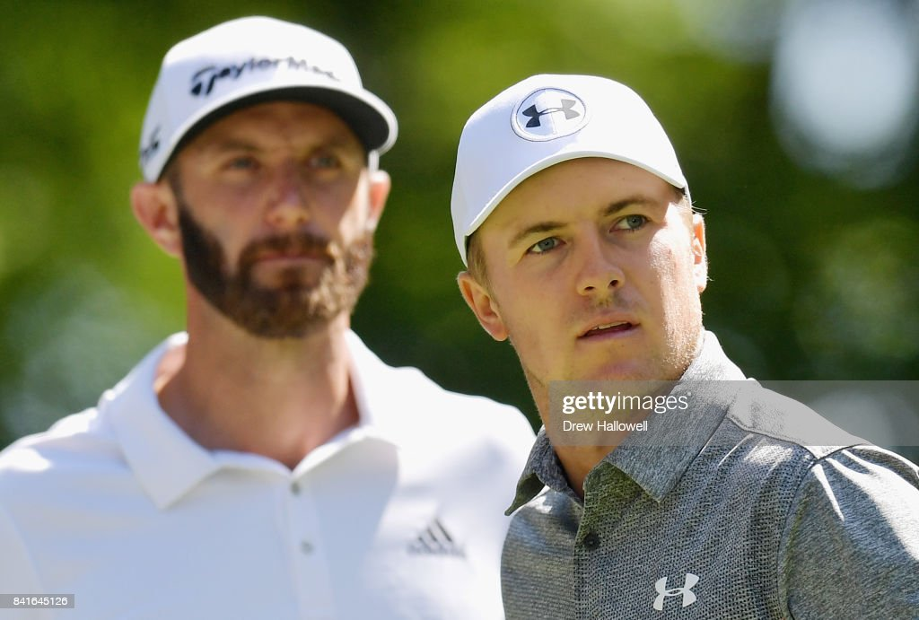 Dustin Johnson and Jordan Spieth of the United States stand on the ninth tee during round one of the Dell Technologies Championship at TPC Boston on September 1, 2017 in Norton, Massachusetts.
