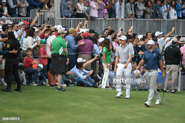 Dustin Johnson and Justin Thomas walk up the 17th hole during the final round of the World Golf ChampionshipsMexico Championship at Club de Golf...