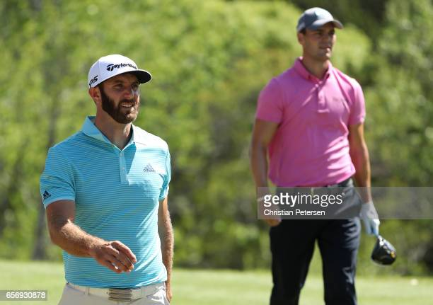 Dustin Johnson and Martin Kaymer of Germany walk on the 3rd hole of his match during round two of the World Golf ChampionshipsDell Technologies Match...