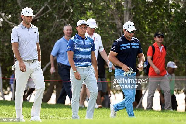 Dustin Johnson and Rickie Fowler of the United States and Ryan Fox of New Zealand walk during the third round of the Abu Dhabi Golf Championship in...