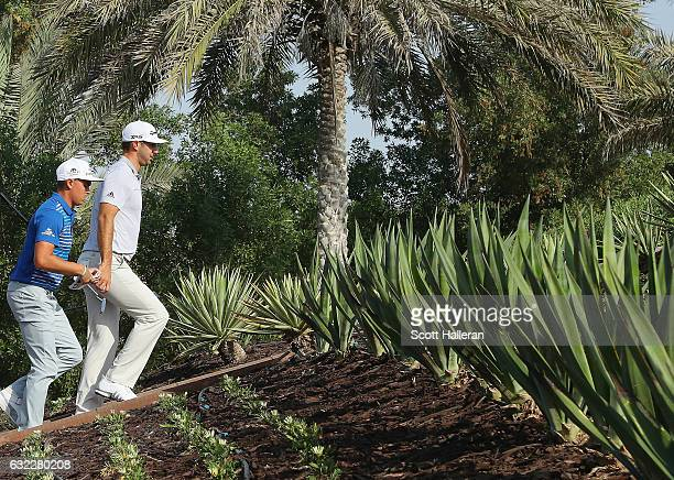 Dustin Johnson and Rickie Fowler of the United States walk to the third hole during the third round of the Abu Dhabi HSBC Championship at Abu Dhabi...
