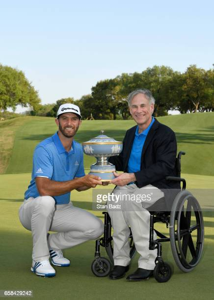 Dustin Johnson and Texas Governor Greg Abbott pose with the Waler Hagen Cup at the World Golf Championships Dell Technologies Match Play at Austin...