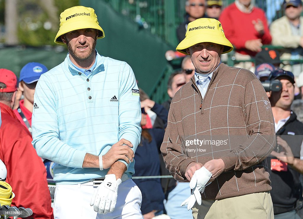 Dustin Johnson (L) and Wayne Gretzky wait on the 17th tee during the third round of the AT&T Pebble Beach National Pro-Am at Pebble Beach Golf Links on February 9, 2013 in Pebble Beach, California.