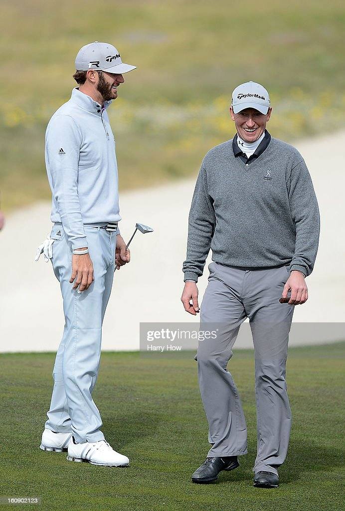 Dustin Johnson (L) and Wayne Gretzky walk up a fairway during the first round of the AT&T Pebble Beach National Pro-Am at the Monterey Peninsula Country Club on February 7, 2013 in Pebble Beach, California.