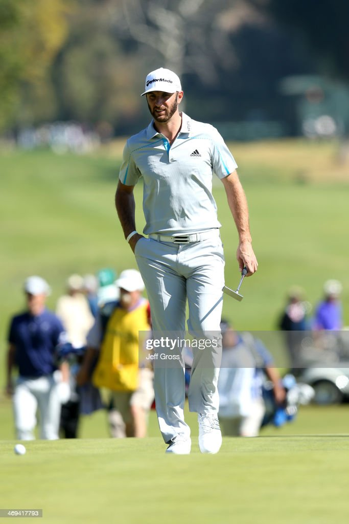 <a gi-track='captionPersonalityLinkClicked' href=/galleries/search?phrase=Dustin+Johnson&family=editorial&specificpeople=3908453 ng-click='$event.stopPropagation()'>Dustin Johnson</a> approaches his ball on the 2nd hole in the second round of the Northern Trust Open at the Riviera Country Club on February 14, 2014 in Pacific Palisades, California.