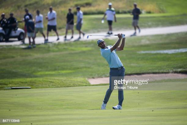Dustin Johnson approaches the green on the 16th hole during the first round of the BMW Championship on Thursday Sept 14 at Conway Farms Golf Club in...