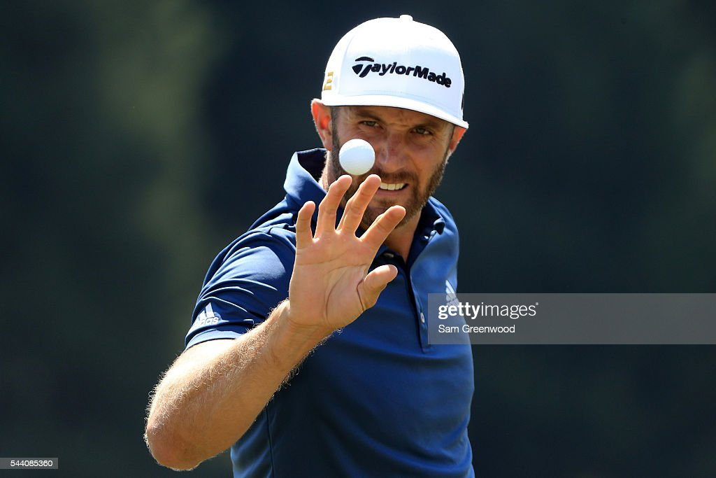 Dustin Johnson catches a ball on the practice range before the second round of the World Golf Championships - Bridgestone Invitational at Firestone Country Club South Course on July 1, 2016 in Akron, Ohio.