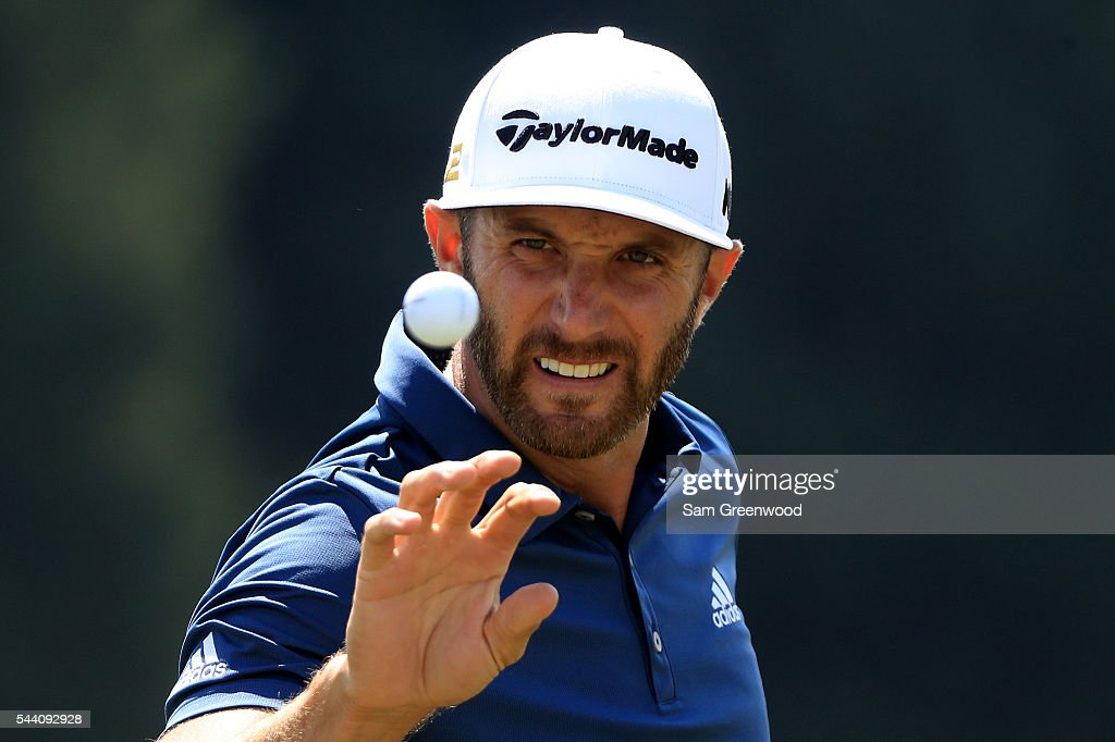 <a gi-track='captionPersonalityLinkClicked' href=/galleries/search?phrase=Dustin+Johnson&family=editorial&specificpeople=3908453 ng-click='$event.stopPropagation()'>Dustin Johnson</a> catches a ball on the practice range before the second round of the World Golf Championships - Bridgestone Invitational at Firestone Country Club South Course on July 1, 2016 in Akron, Ohio.