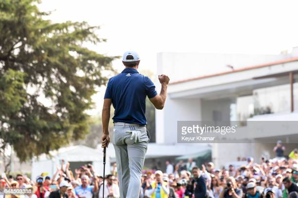 Dustin Johnson celebrates his victory on the 18th hole green during the final round of the World Golf ChampionshipsMexico Championship at Club de...