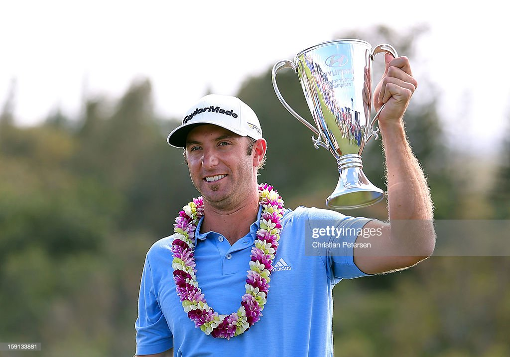 Dustin Johnson celebrates with the Hyundai Tournament of Champions Cup after winning following the final round at the Plantation Course on January 8, 2013 in Kapalua, Hawaii.