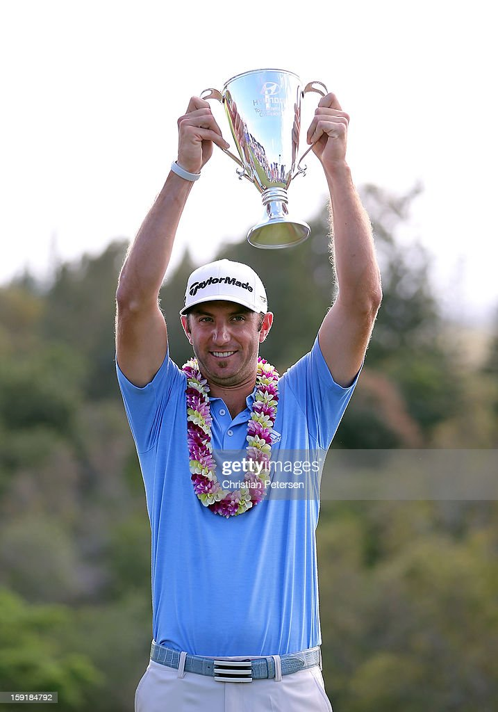 Dustin Johnson celebrates with the Hyundai Tournament of Champions Cup after winning in the final round at the Plantation Course on January 8, 2013 in Kapalua, Hawaii.