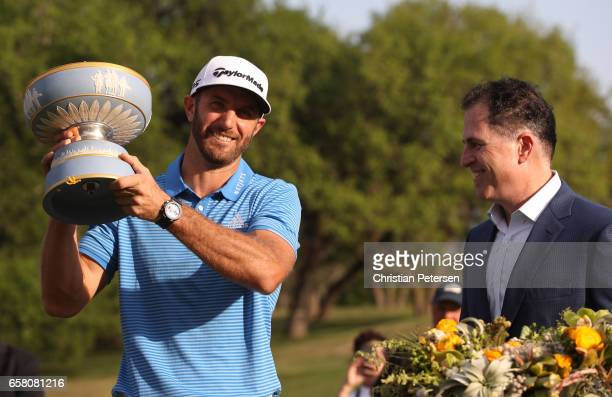 Dustin Johnson celebrates with the trophy after winning the World Golf ChampionshipsDell Technologies Match Play at the Austin Country Club on March...