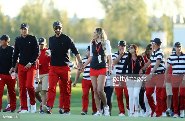 Dustin Johnson Daniel Berger and other members of the US Team walk up the 14th fairway to the trophy ceremony after defeating the International Team...