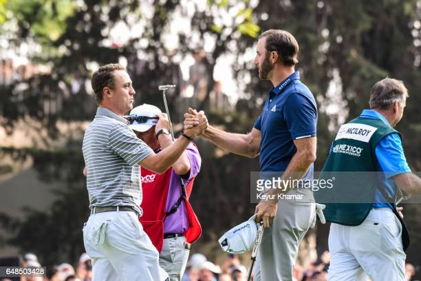 Dustin Johnson greets Justin Thomas after his victory on the 18th hole green during the final round of the World Golf ChampionshipsMexico...