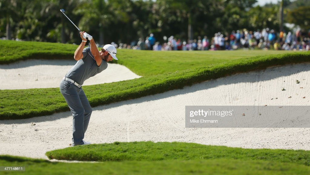 <a gi-track='captionPersonalityLinkClicked' href=/galleries/search?phrase=Dustin+Johnson&family=editorial&specificpeople=3908453 ng-click='$event.stopPropagation()'>Dustin Johnson</a> hits a bunker shot on the seventh hole during the second round of the World Golf Championships-Cadillac Championship at Trump National Doral on March 7, 2014 in Doral, Florida.