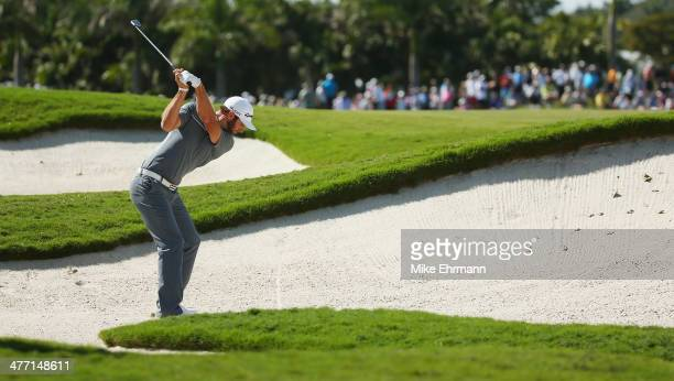 Dustin Johnson hits a bunker shot on the seventh hole during the second round of the World Golf ChampionshipsCadillac Championship at Trump National...