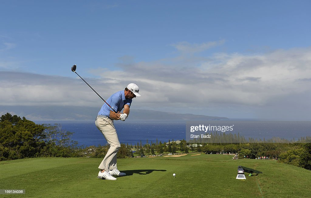 Dustin Johnson hits a drive on the 17th hole during the final round of the Hyundai Tournament of Champions at Plantation Course at Kapalua on January 8, 2013 in Kapalua, Maui, Hawaii.