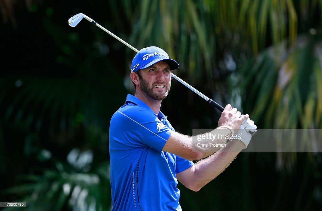Dustin Johnson hits a shot during a practice round prior to the start of the World Golf Championships-Cadillac Championship at Trump National Doral on March 5, 2014 in Doral, Florida.