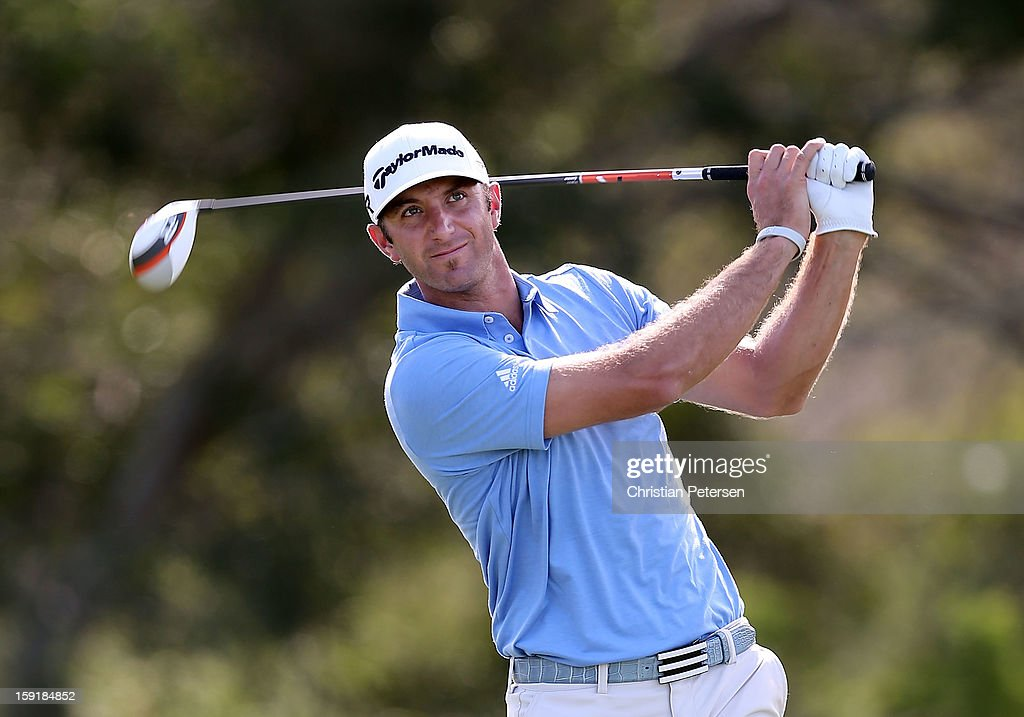 Dustin Johnson hits a tee shot on 18th hole during the final round of the Hyundai Tournament of Champions at the Plantation Course on January 8, 2013 in Kapalua, Hawaii.