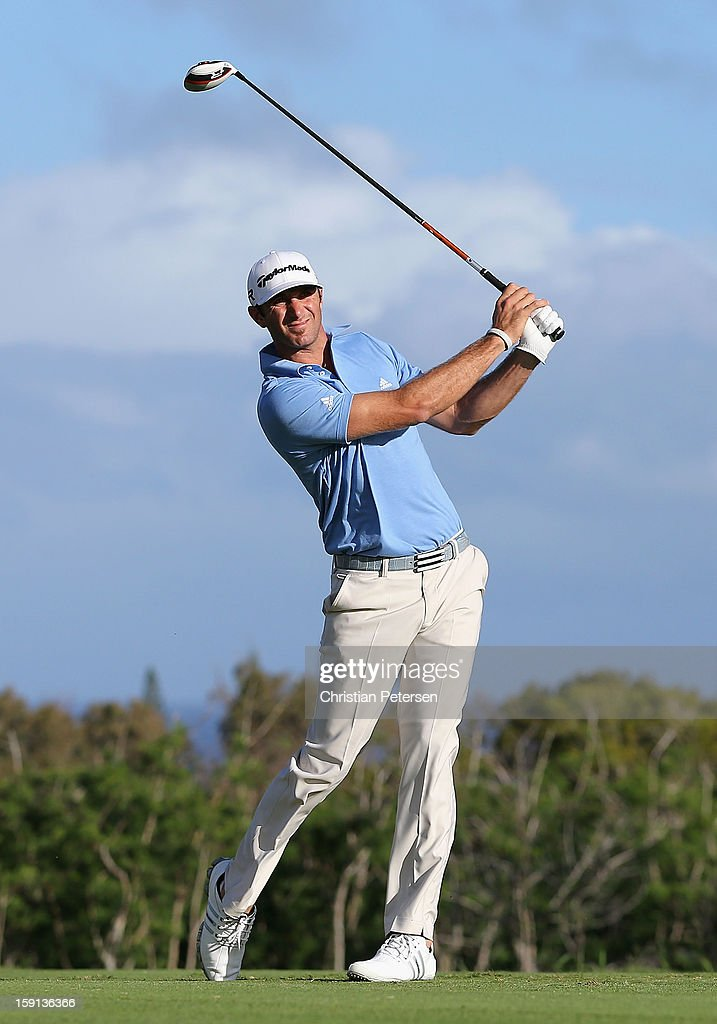 Dustin Johnson hits a tee shot on fourth hole during the final round of the Hyundai Tournament of Champions at the Plantation Course on January 8, 2013 in Kapalua, Hawaii.