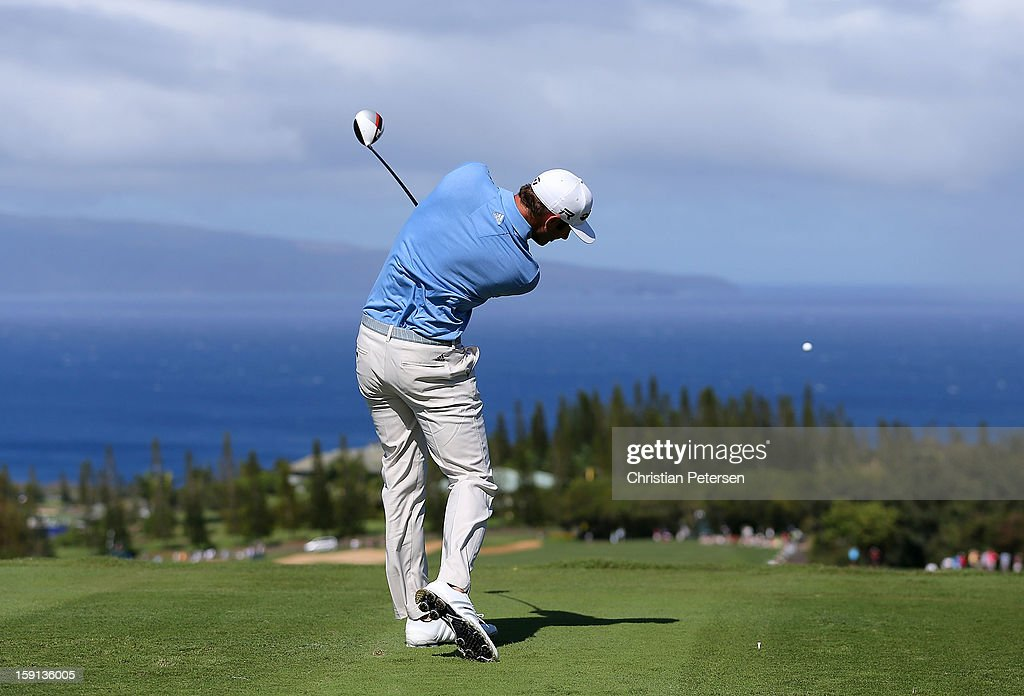 Dustin Johnson hits a tee shot on the 17th hole during the final round of the Hyundai Tournament of Champions at the Plantation Course on January 8, 2013 in Kapalua, Hawaii.
