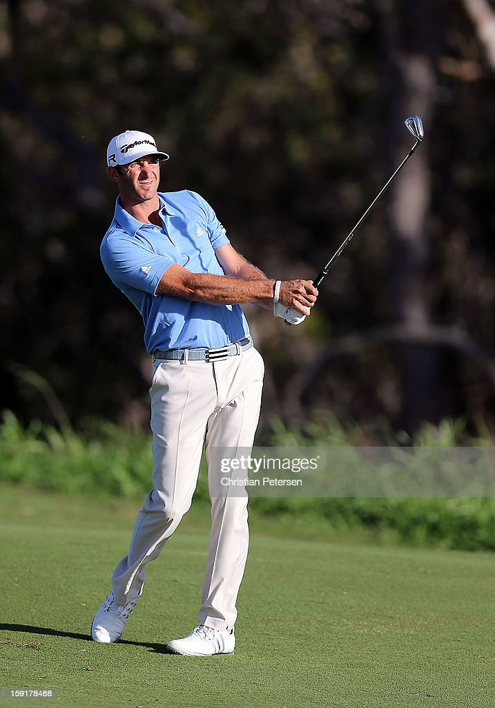 Dustin Johnson hits his second shot on the fourth hole during the final round of the Hyundai Tournament of Champions at the Plantation Course on January 8, 2013 in Kapalua, Hawaii.