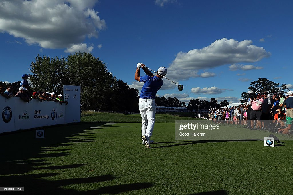 Dustin Johnson hits his tee shot on the 18th hole during the final round of the BMW Championship at Crooked Stick Golf Club on September 11, 2016 in Carmel, Indiana.