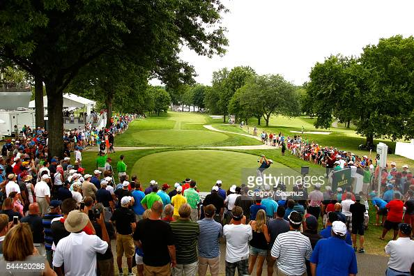Dustin Johnson hits off the 18th tee during the final round of the World Golf Championships Bridgestone Invitational at Firestone Country Club South...