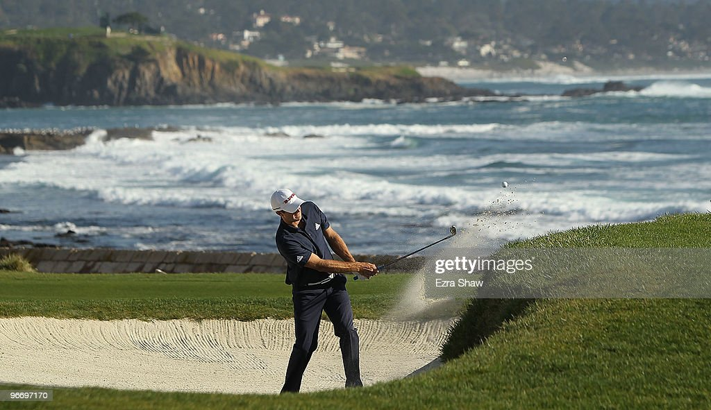 Dustin Johnson hits out of the bunker on the 18th hole during the final round of the ATT Pebble Beach National ProAm at Pebble Beach Golf Links on...