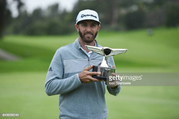 Dustin Johnson holds up the trophy after winning the Genesis Open golf tournament at the Riviera Country Club on February 19 2017