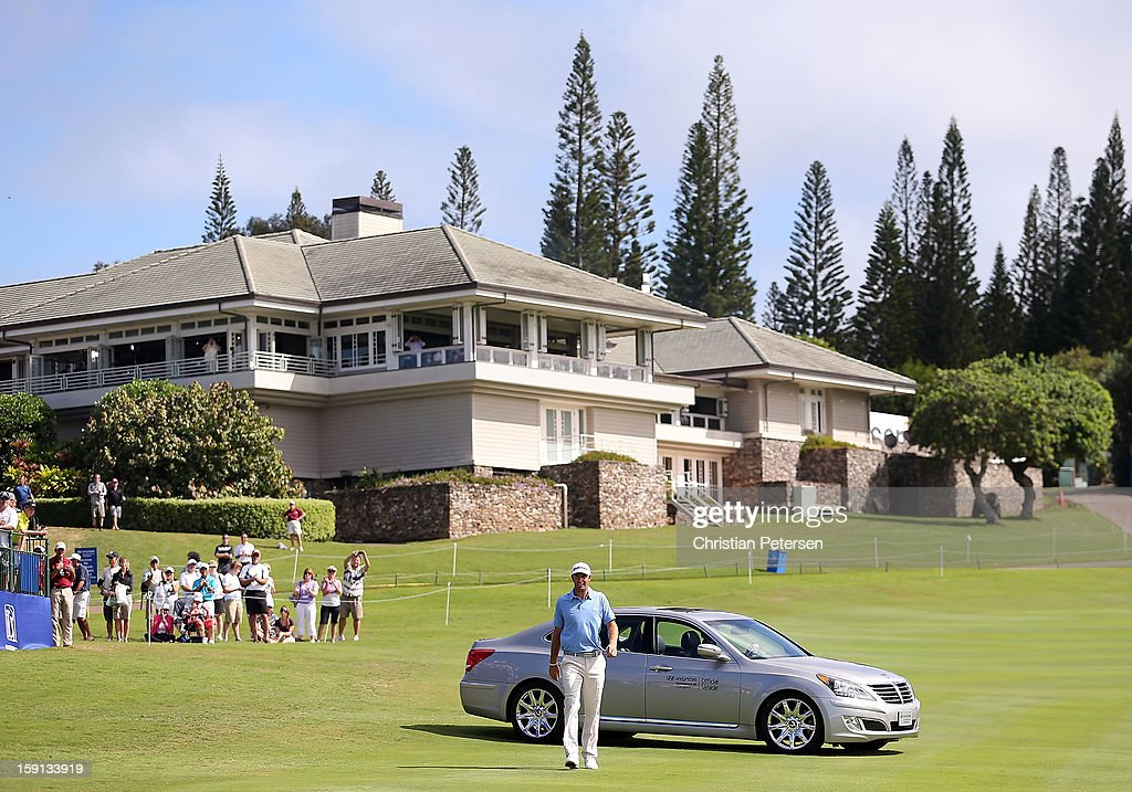 Dustin Johnson is driven up to the 18th hole green in a Hyundai after winning the Hyundai Tournament of Champions following the final round at the Plantation Course on January 8, 2013 in Kapalua, Hawaii.