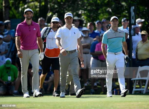 Dustin Johnson Justin Thomas and Rory McIlroy of Northern Ireland tees off on the 15th hole during the second round of THE PLAYERS Championship on...