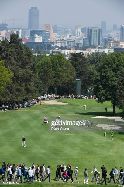 Dustin Johnson Justin Thomas and Rory McIlroy of Northern Ireland walk up the 10th fairway during the final round of the World Golf...