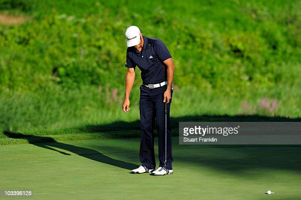 Dustin Johnson misses his par putt on the 18th green during the final round of the 92nd PGA Championship on the Straits Course at Whistling Straits...