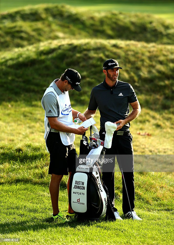 Dustin Johnson of the JUnited States lines up for his second shot on the fourteenth fairway during round one of the Deutsche Bank Championship at TPC Boston on September 4, 2015 in Norton, Massachusetts.