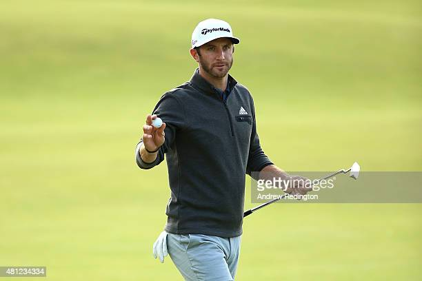 Dustin Johnson of the United States acknowledges the crowd on the 18th green during the second round of the 144th Open Championship at The Old Course...