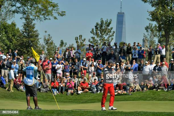 Dustin Johnson of the United States acknowledges the gallery on the second hole during the Sunday singles matches at the Presidents Cup at Liberty...