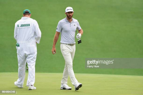 Dustin Johnson of the United States and Austin Johnson on the tenth green during a practice round prior to the start of the 2017 Masters Tournament...