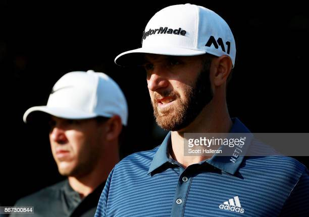 Dustin Johnson of the United States and Brooks Koepka of the United States walk form the 16th tee during the third round of the WGC HSBC Champions at...