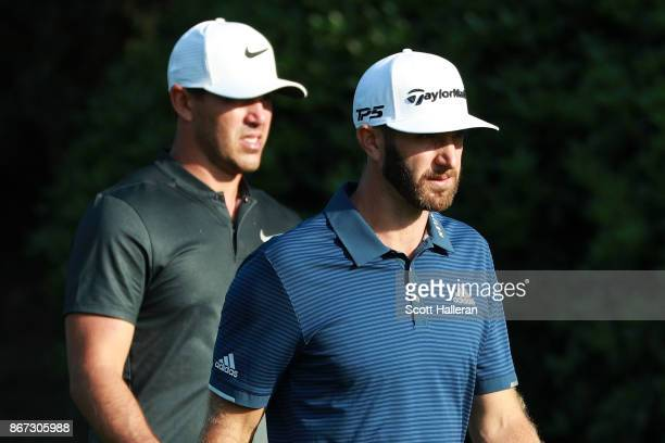Dustin Johnson of the United States and Brooks Koepka of the United States walk on the 15th hole during the third round of the WGC HSBC Champions at...