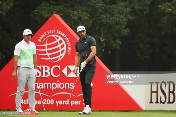 Dustin Johnson of the United States and Brooks Koepka of the United States stand on the fourth tee during the final round of the WGC HSBC Champions...