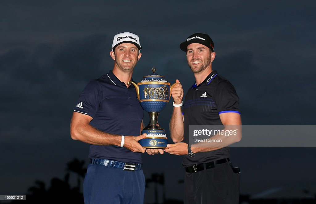 <a gi-track='captionPersonalityLinkClicked' href=/galleries/search?phrase=Dustin+Johnson&family=editorial&specificpeople=3908453 ng-click='$event.stopPropagation()'>Dustin Johnson</a> of the United States and brother Austin poses with the <a gi-track='captionPersonalityLinkClicked' href=/galleries/search?phrase=Gene+Sarazen&family=editorial&specificpeople=890883 ng-click='$event.stopPropagation()'>Gene Sarazen</a> Cup after winning the World Golf Championships-Cadillac Championship at Trump National Doral Blue Monster Course on March 8, 2015 in Doral, Florida.