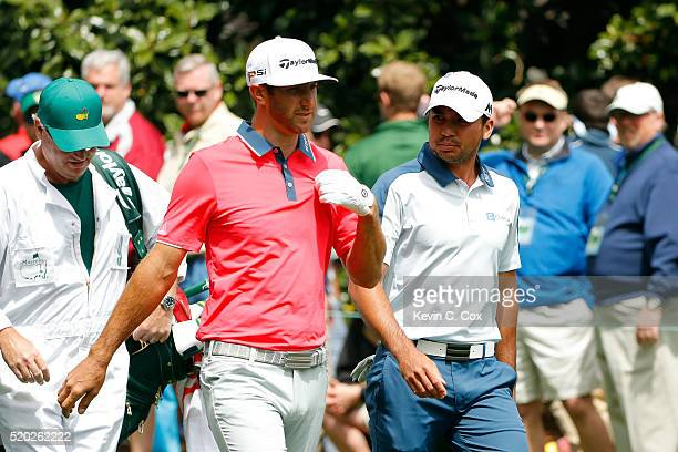 Dustin Johnson of the United States and Jason Day of Australia walk from the seocnd tee during the final round of the 2016 Masters Tournament at...