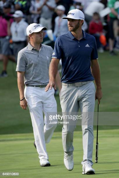 Dustin Johnson of the United States and Justin Thomas of the United States walks to the green on the 18th hole during the final round of the World...