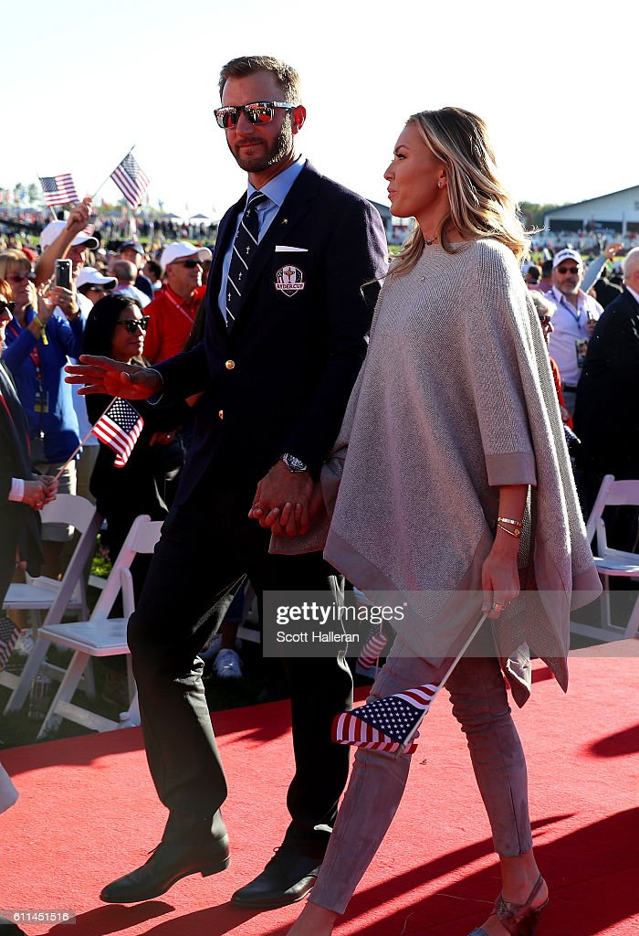 Dustin Johnson of the United States and Paulina Gretzky depart during the 2016 Ryder Cup Opening Ceremony at Hazeltine National Golf Club on September 29, 2016 in Chaska, Minnesota.