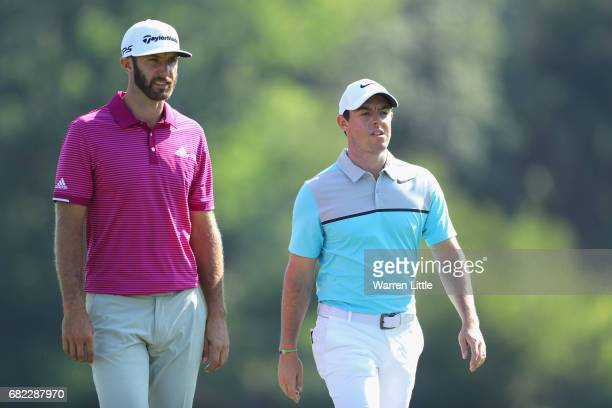 Dustin Johnson of the United States and Rory McIlroy of Northern Ireland walk on the 14th hole during the second round of THE PLAYERS Championship at...