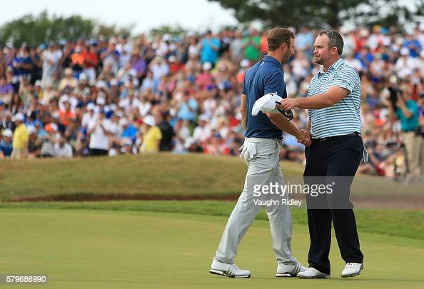 Dustin Johnson of the United States and Steve Wheatcroft of the United States shakes hands after their round on the 18th green during the final round...