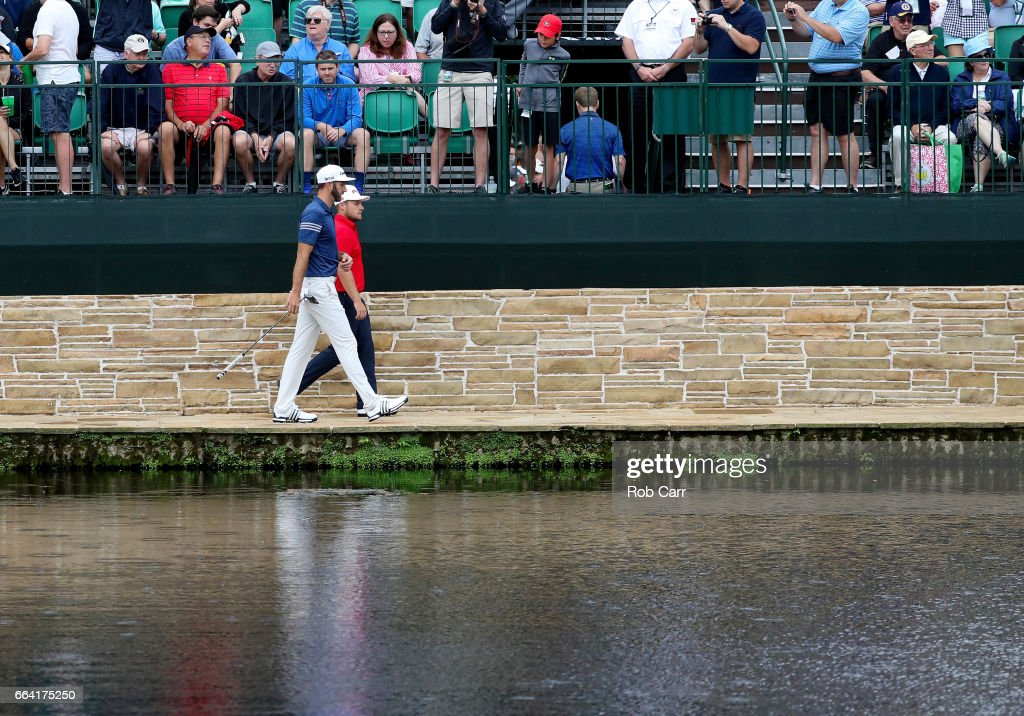 Dustin Johnson of the United States and Tyrrell Hatton of England walk during a practice round prior to the start of the 2017 Masters Tournament at Augusta National Golf Club on April 3, 2017 in Augusta, Georgia.