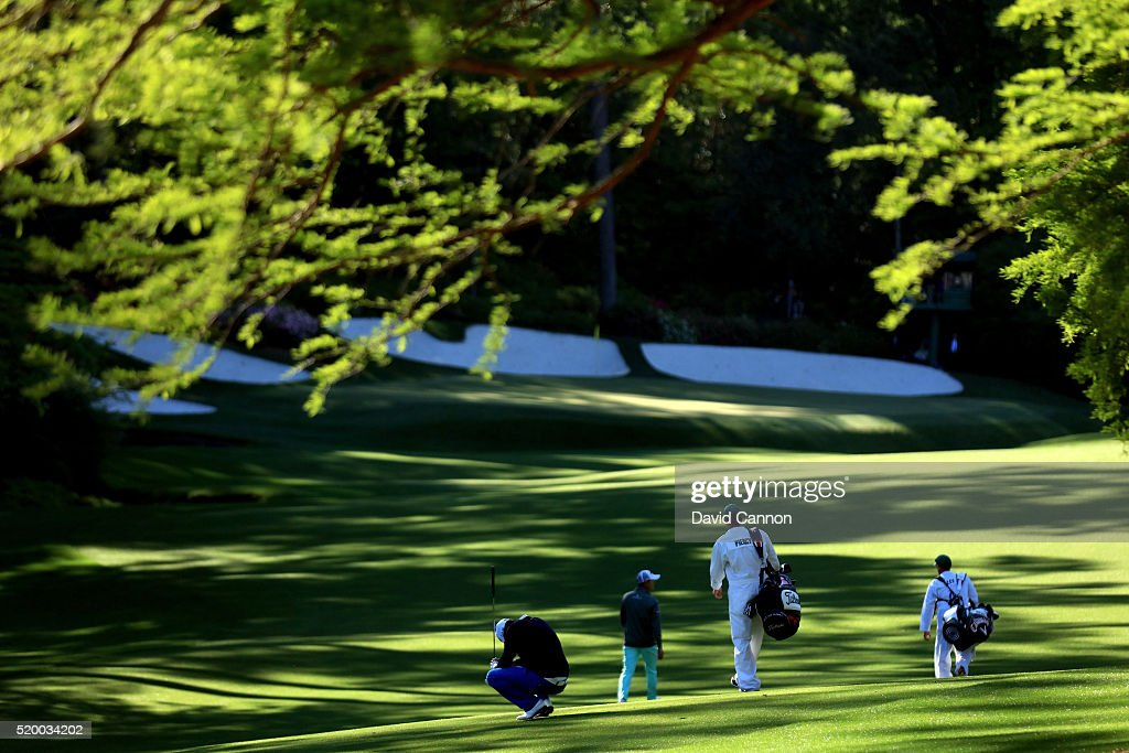 Dustin Johnson of the United States caddie Austin Johnson Danny Lee of New Zealand and caddie Mike Hartford walk on the 13th hole during the third...