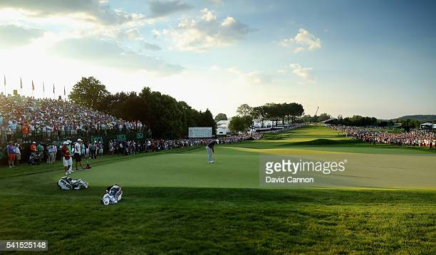 Dustin Johnson of the United States celebrates his birdie putt on the 18th green during the final round of the US Open at Oakmont Country Club on...